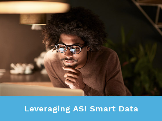 Man staring intently at laptop. Text reads: Leveraging ASI Smart Data