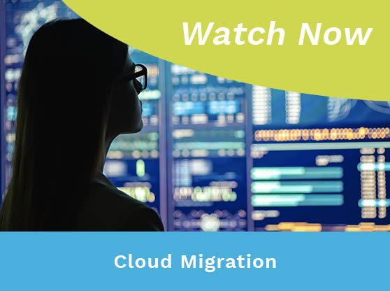 Woman staring at multiple screen displays. Text Reads: Cloud Migration