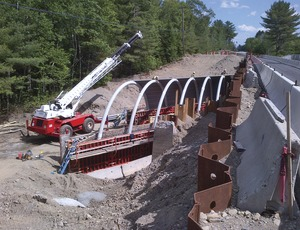 A Bridge-in-a-Backpack being erected in Maine. Image courtesy of ENR.com and Maine DOT.