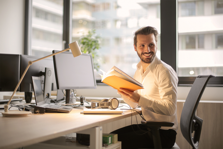 Smiling man sitting at his work desk