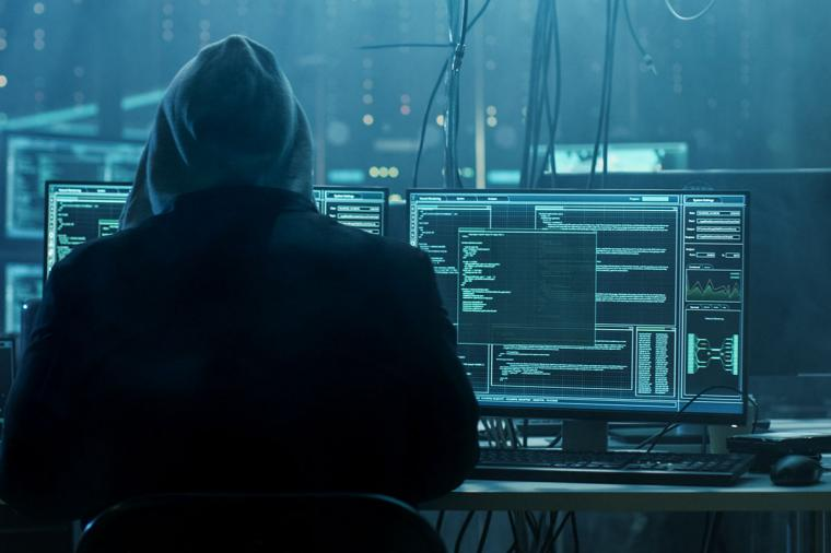 photo of person sitting at desk hacking