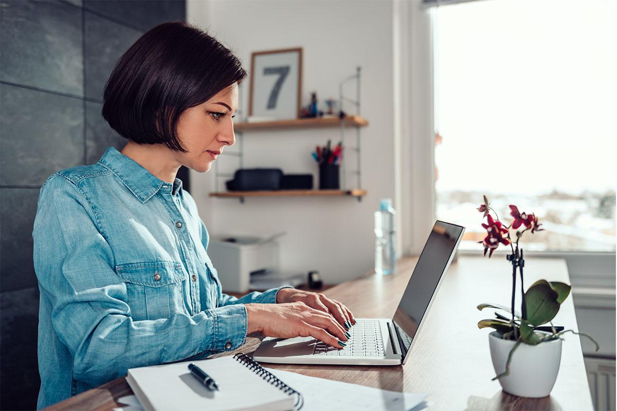 woman sitting at home on laptop
